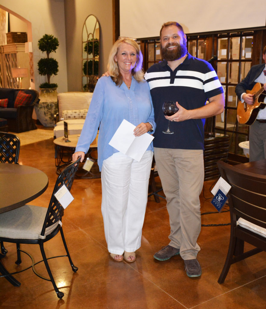 Winner, Chris Derksen with Store Manager, Celeste Russell