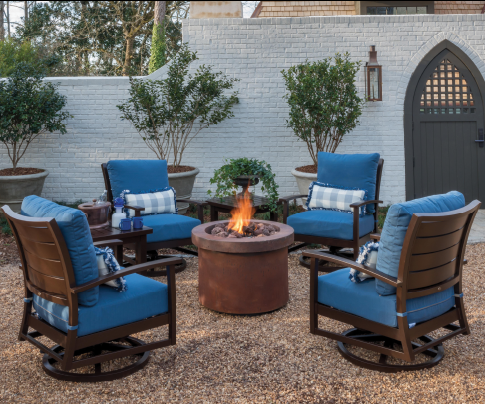 Firepit and Charleston aluminum swivel rockers in blue outdoor fabrics